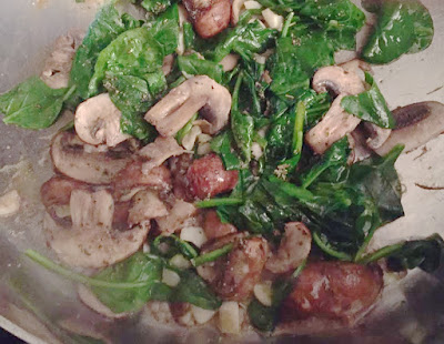 Spinach and mushrooms in pan