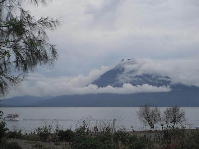 Lake Atitlan Panajachel Guatemala Volcan San Pedro volcano rainy season rain clouds