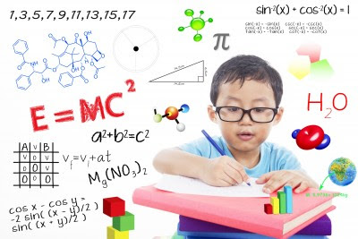 A little boy solving complex maths