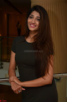 Priya Vadlamani super cute in tight brown dress at Stone Media Films production No 1 movie announcement 065.jpg