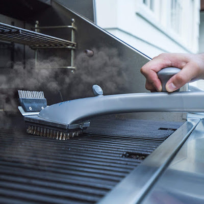 Cleaning a grill with Grill Daddy Brush