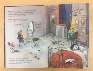 Two-page spread showing Ghoulia's bedroom, with her admiring her relection in the mirror and sleeping in bed.