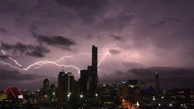Lightning and the neon lights of the Brisbane 2015