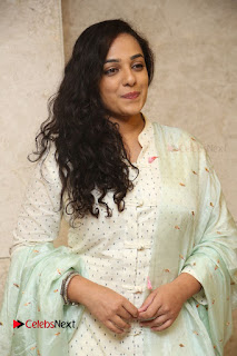 Actress Nithya Menen Latest Pictures in White Dress at 100 Days of Love Movie Audio Launch  0106