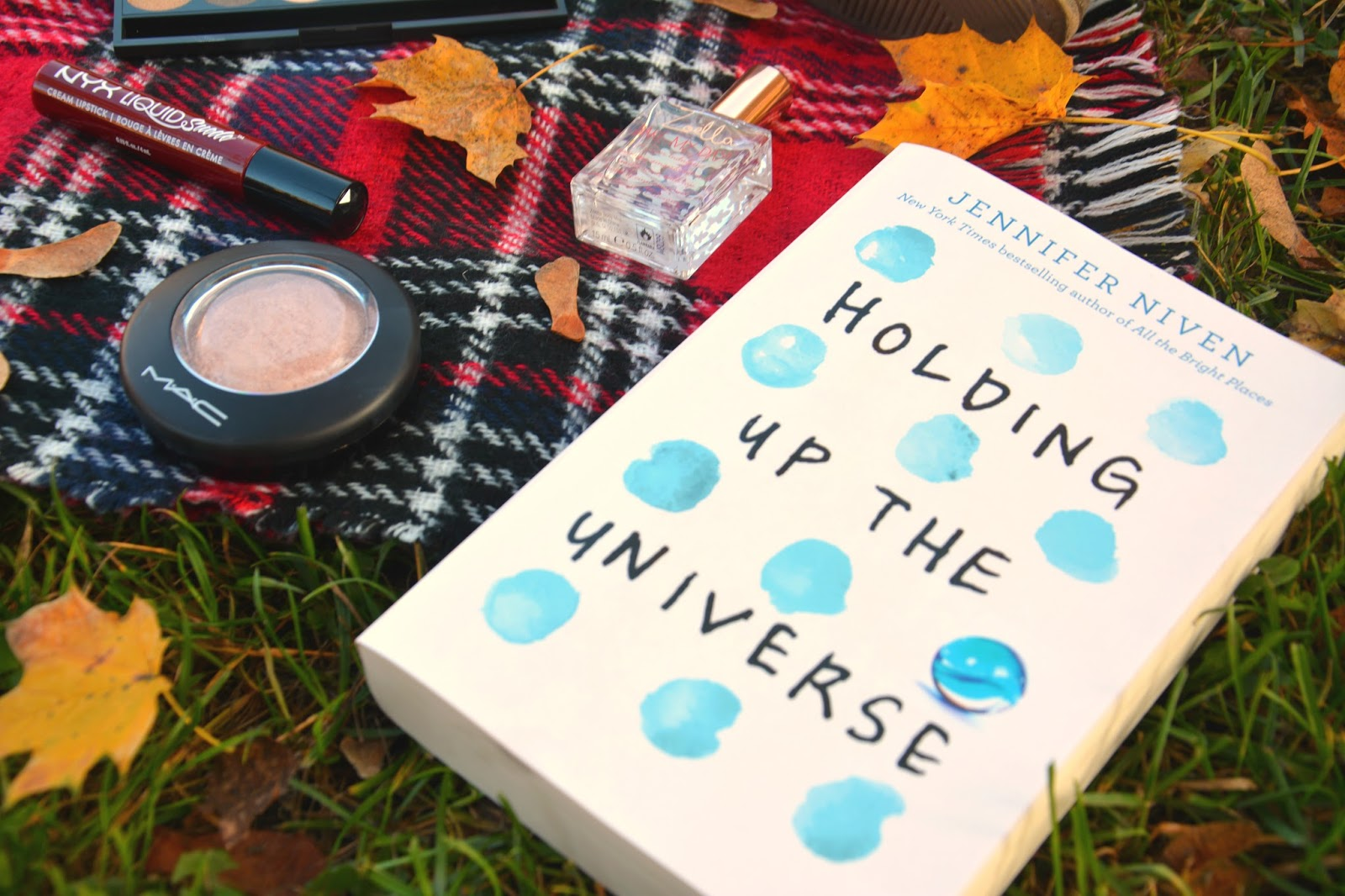 Holding Up the Universe Book, Mac Soft & Gentle Highlighter, NYX Liquid Suede Cherry Skies, Zoella Bake My Day Body Mist, Primark Blanket Scarf