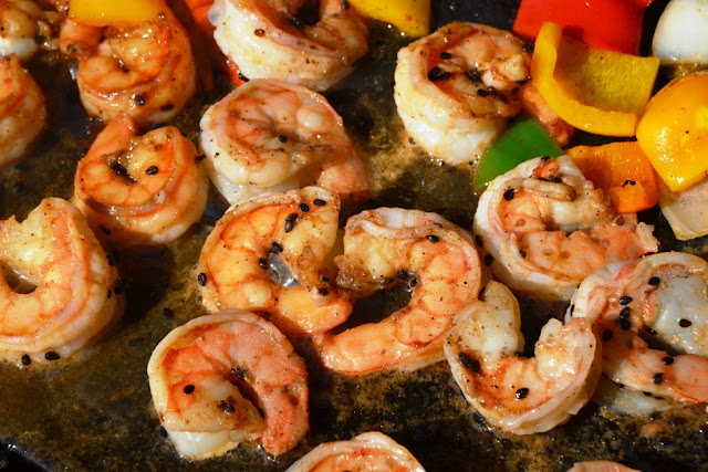 Grilled Sesame Asian Shrimp and Vegetables takes 20 minutes to make and is marinated in a delicious tangy marinade and filled with vegetables for a perfect meal! www.nutritionistreviews.com