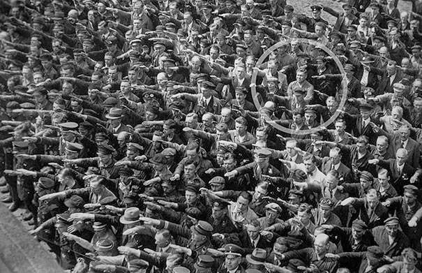 These 15 Incredibly Rare Historical Photos Will Leave You Speechless - He stood alone, refusing to join the Nazi salute in 1936.