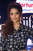 Ritika Singh in Black Printed Shirt and White Leggings at IIFA Utsavam Awards press meet 27th March 2017 11.JPG