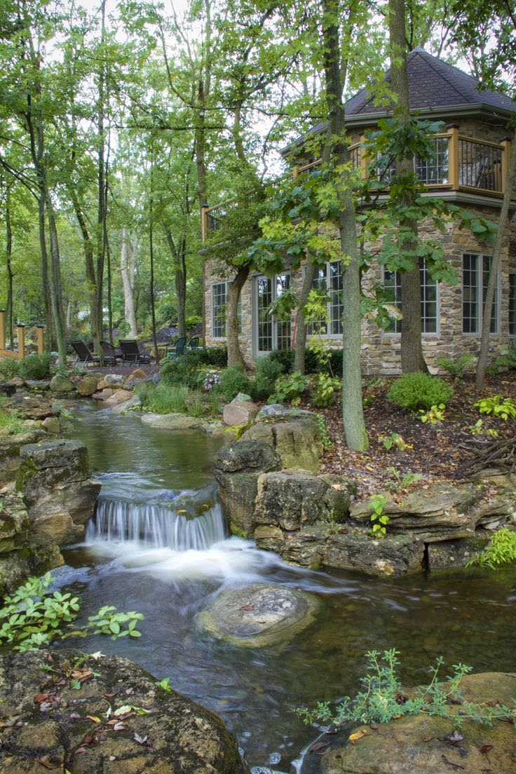 Waterfalls and streams run throughout the backyard ...
