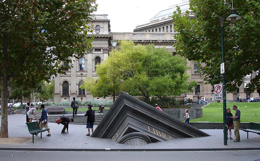42 Of The Most Beautiful Sculptures In The World - Sinking Building Outside State Library, Melbourne, Australia