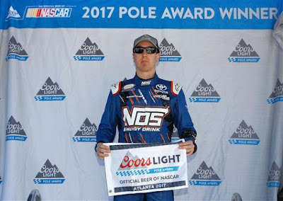 Kyle Busch, driver of the #18 NOS Energy Drink Toyota, poses with the  Coors Light Pole Award.