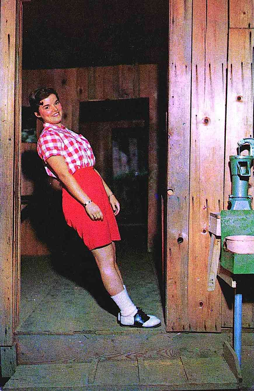 a 1950s slanted house illusion, color photograph