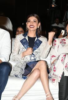 Kajal Aggarwal Smiling pics in a Short White Dress At Launching Entha Varaku Ee Prema Music