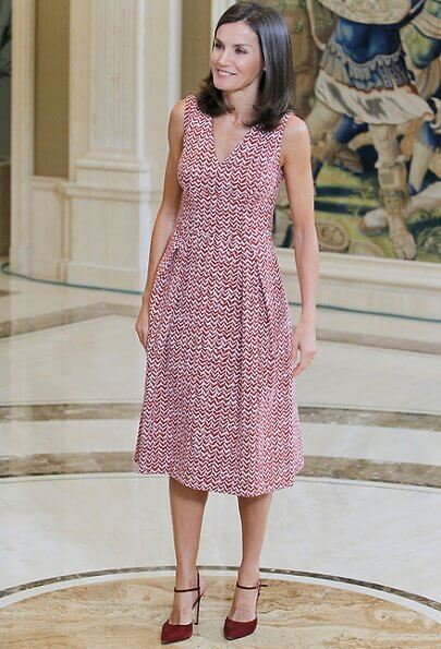 Queen Letizia wore a v-neck zig-zag print midi dress by Carolina Herrera and Lodi burgundy suede ankle strap pumps