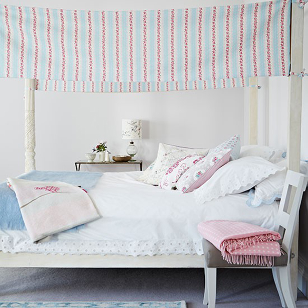 Four Poster Bed with Clarke and Clarke awning and pillows