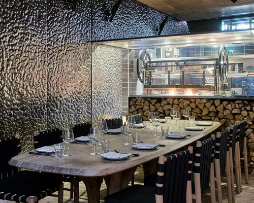 www.Tinuku.com Design interior Fucina restaurant with two bells brick roof dripped by Andy Martin Architects