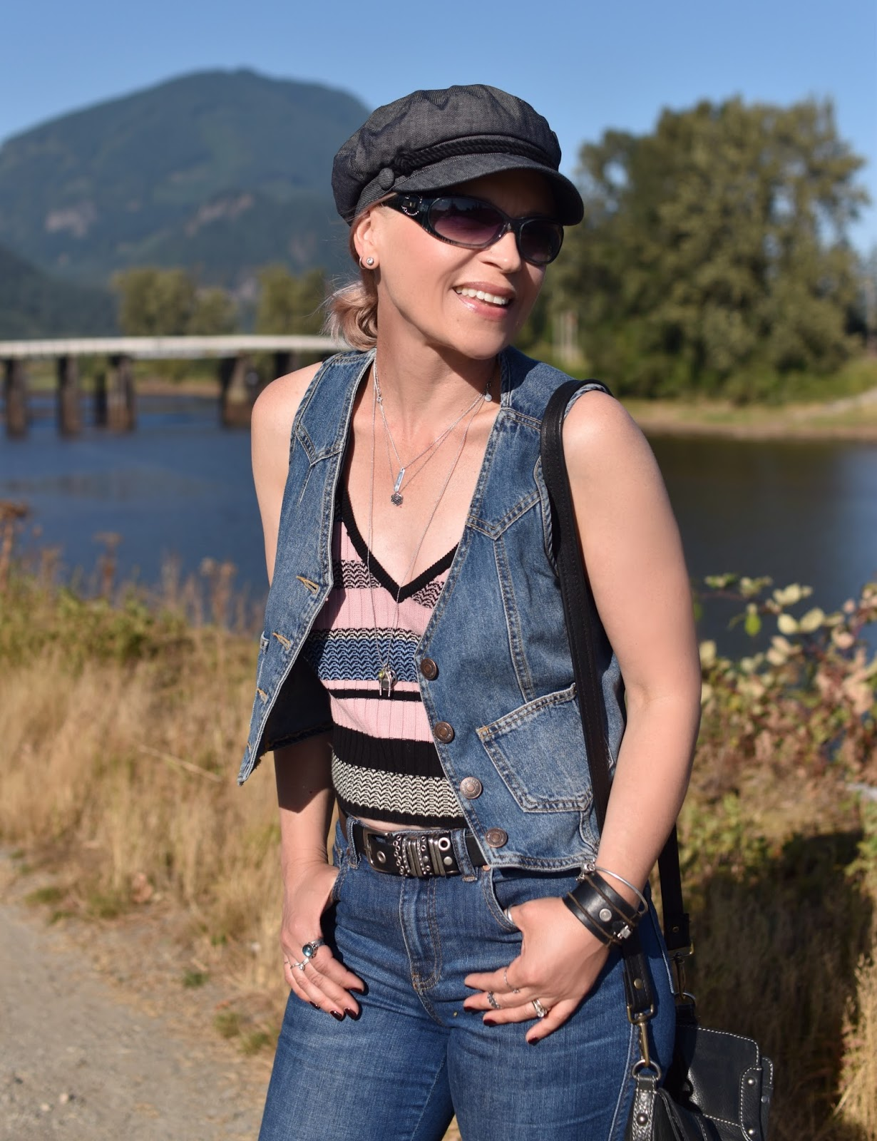 Monika Faulkner outfit inspiration - jeans, striped tank top, denim vest, baker boy cap