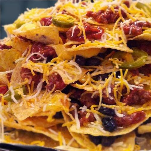 Layered Nachos Prepped Before Oven