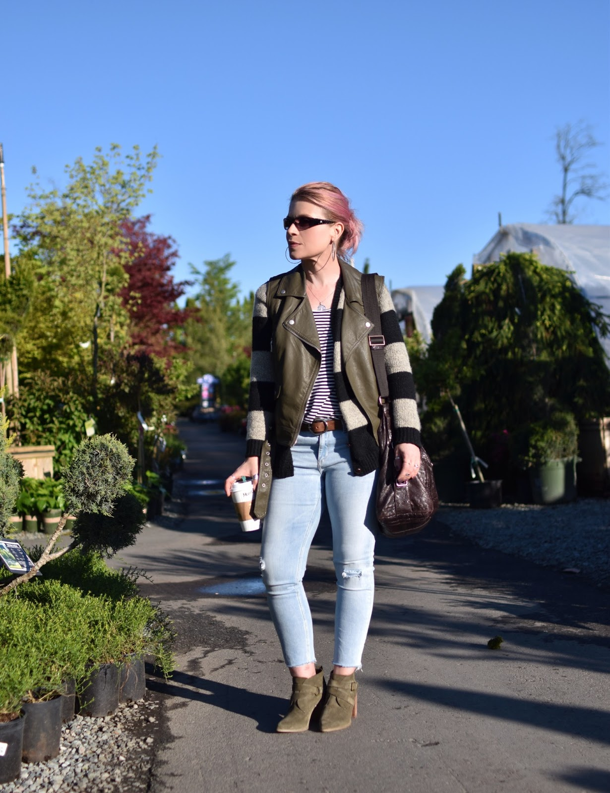 Monika Faulkner outfit inspiration - layered stripes with a moto vest, skinny jeans, and booties