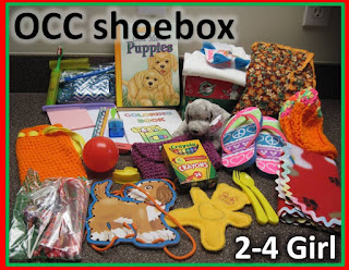 OCC Shoebox for 2 to 4 year old girl with clothing.