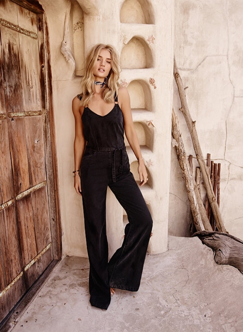 Rosie Huntington-Whiteley poses in Paige Denim's Hazelle jumpsuit