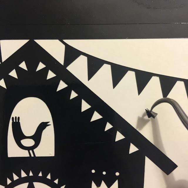 Applying vinyl to glass tutorial by Nadine Muir for UK Silhouette Blog.  Weeding tool