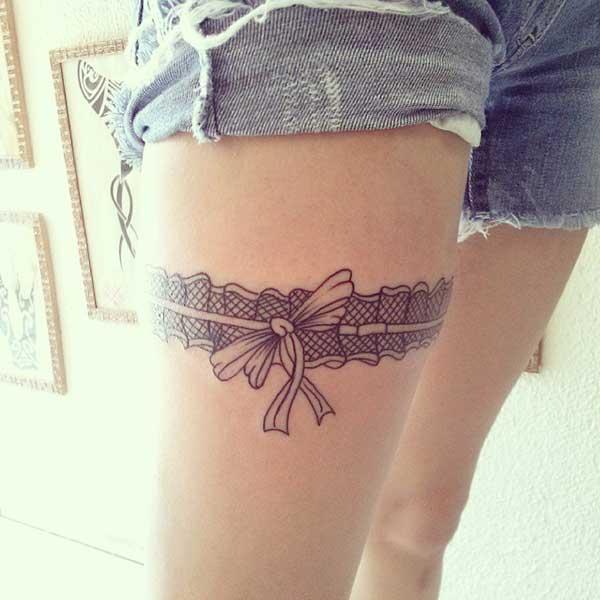 girly garter tattoo