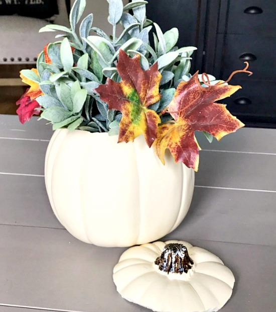 Fall centerpiece with faux plants and fall leaves