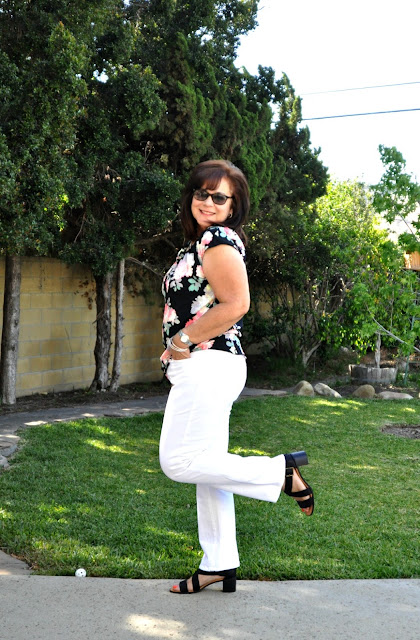 black floral blouse and white jeans - fashion