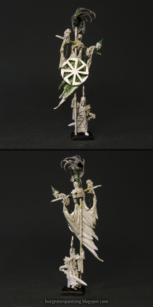 An unpainted Wight King miniature from Forge World, slightly converted - with a plasticard sigil hanging in front of the banner.