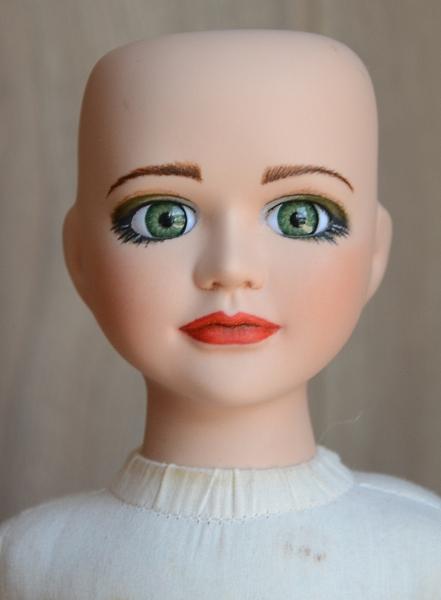 Porcelain doll repaint.