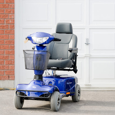 An outdoor mobility scooter used for those with walking disabilities.