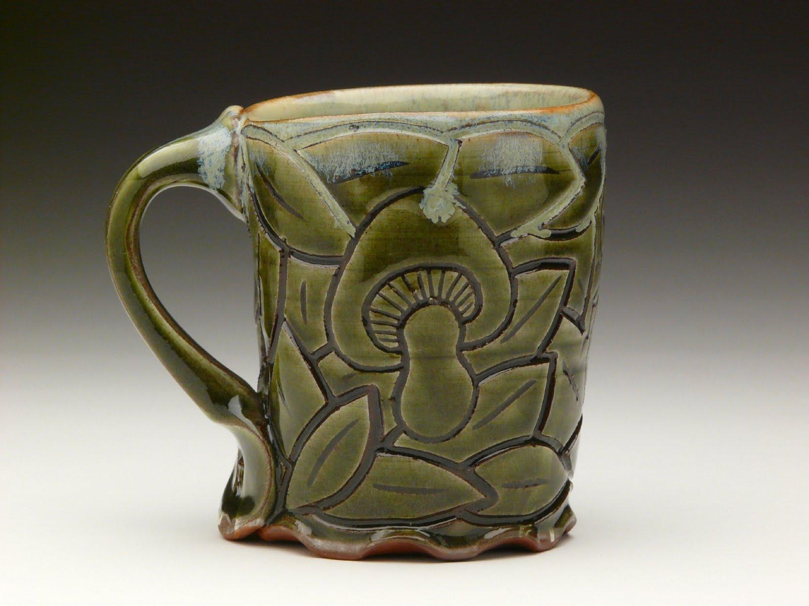 green mug with mushies on it.