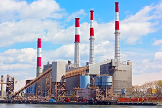 Fossil fuel burning electric power plant