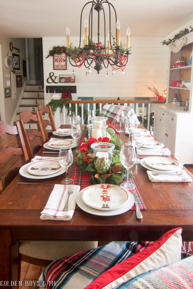 Farmhouse style dining room with shiplap and traditional holiday table setting