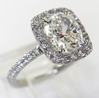 http://www.ebay.com/itm/GIA-3-0CT-cushion-diamond-platinum-engagement-ring-round-brilliant-GVS2-halo-/371589233829?hash=item568471bca5