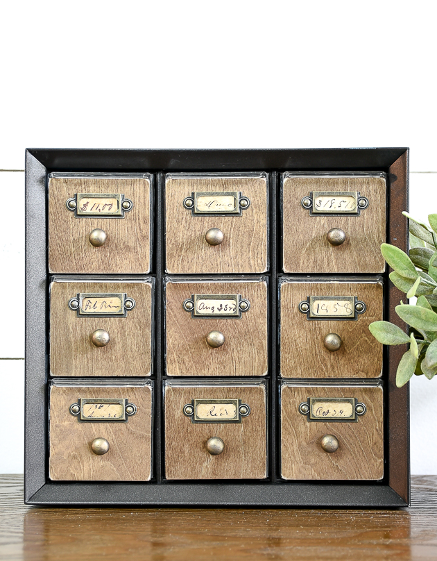 hardware cabinet turned vintage card catalog using metal label holder from michales