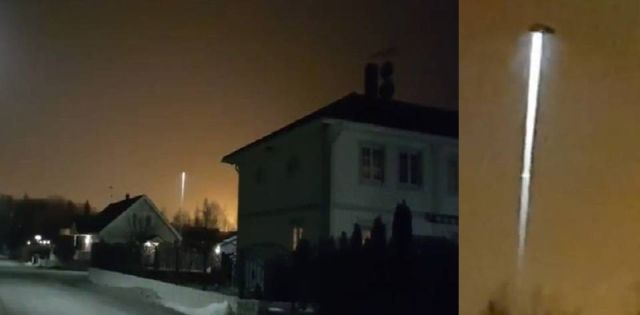 UFO Beam appears in strange orange sky over Stockholm, Sweden  UFO%2BBeam%2BOrange%2BSky%2BSweden