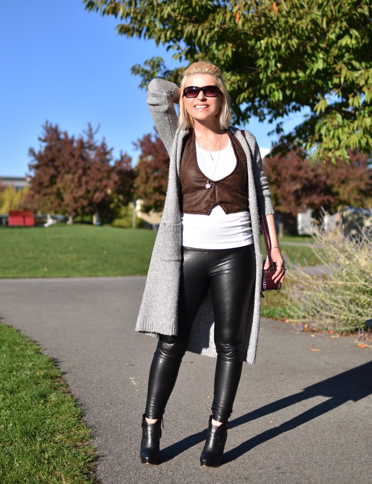 Outfit inspiration c/o Monika Faulkner - vegan leather vest and leggings with wedge booties and a long cardigan