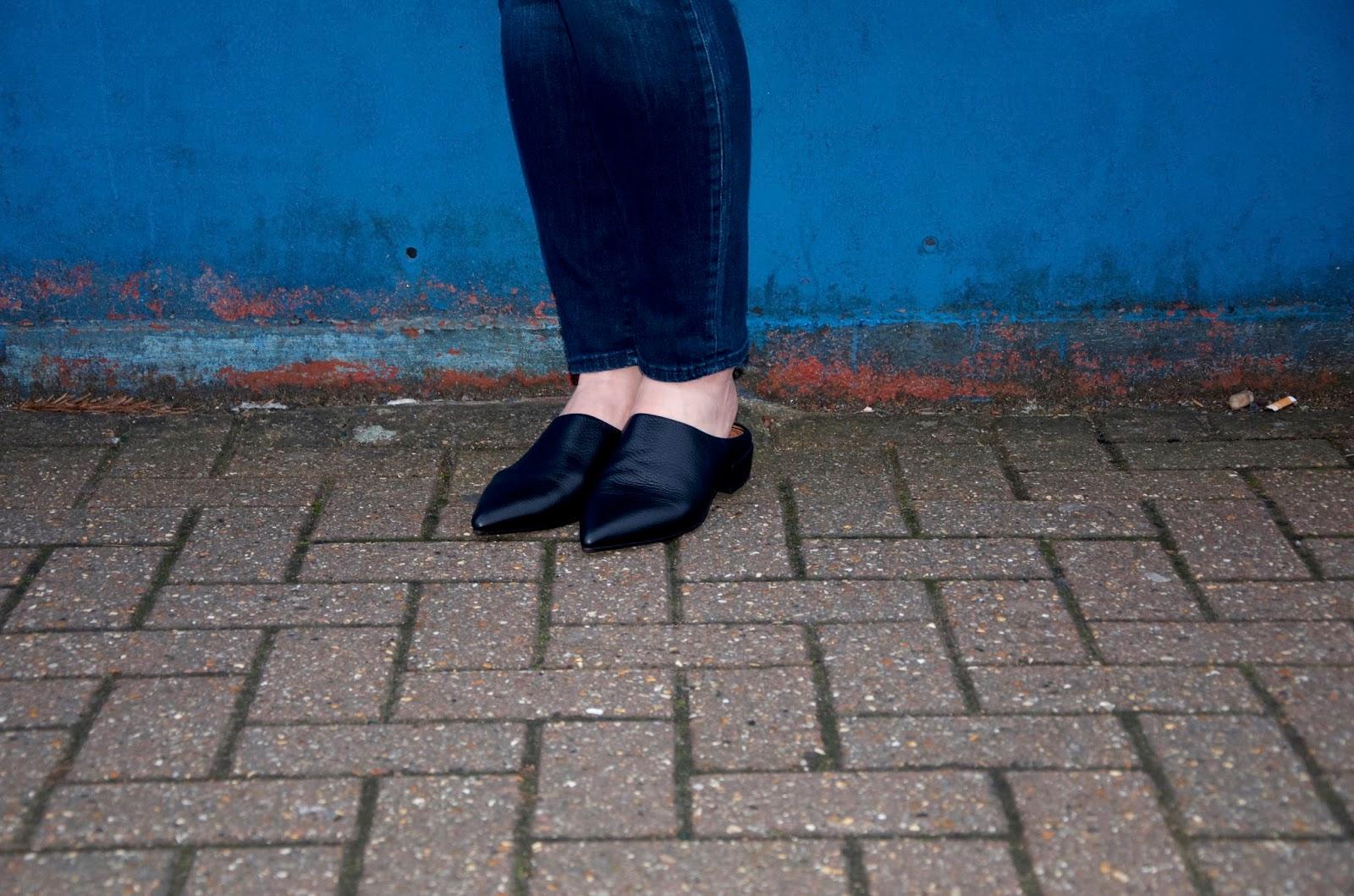 black pointed toe leather slides