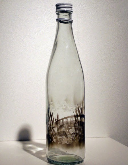 smoky glass bottle that hold the story and beauty