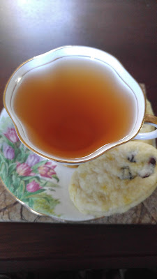 Top Down photo of Antique Garden Tea Cup with Cranberry-Orange Scones from PlumPetite.blogspot.com