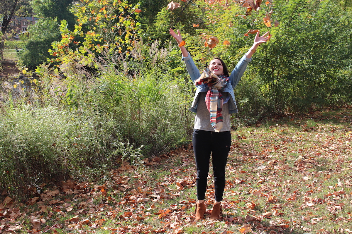 This is a photo of me throwing leaves in the air.