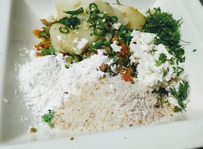 Vegetables Corn flour bread crumbs chilly cilantro Potato in mixing bowl for Vegan Patty Hara bhara kabab Recipe