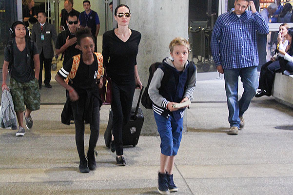 To Cambodia and back again: Angelina Jolie with kids at the airport in Los Angeles
