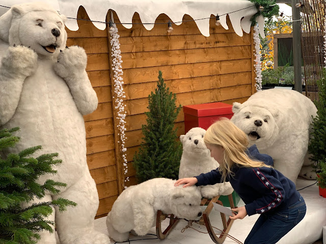 Stroking a pretend baby polar bear outside Santa's Grotto Wyevale