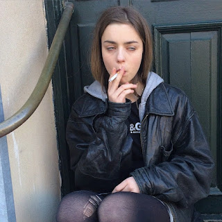 blissful smoker enjoying cig