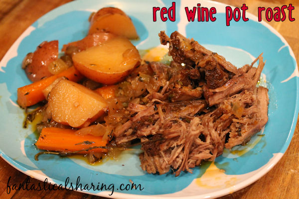 Red Wine Pot Roast // This roast is perfect for a dinner party and is all sorts of lovely with the rich red wine in it. #wine #roast #maindish #recipe