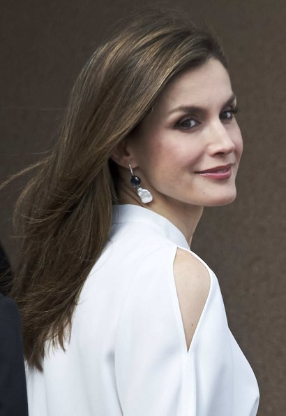 Queen Letizia wore Adolfo Dominguez short sleeve cold shoulder blouse and Hugo Boss Skirt