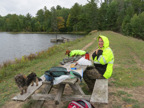 hikers eating lunch at a picnic table